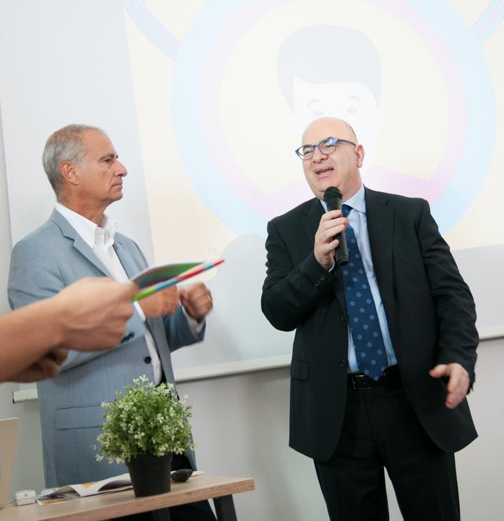 Carlo Parisi insieme ad Antonio Messina alla cerimonia di consegna del Premio giornalistico Merck
